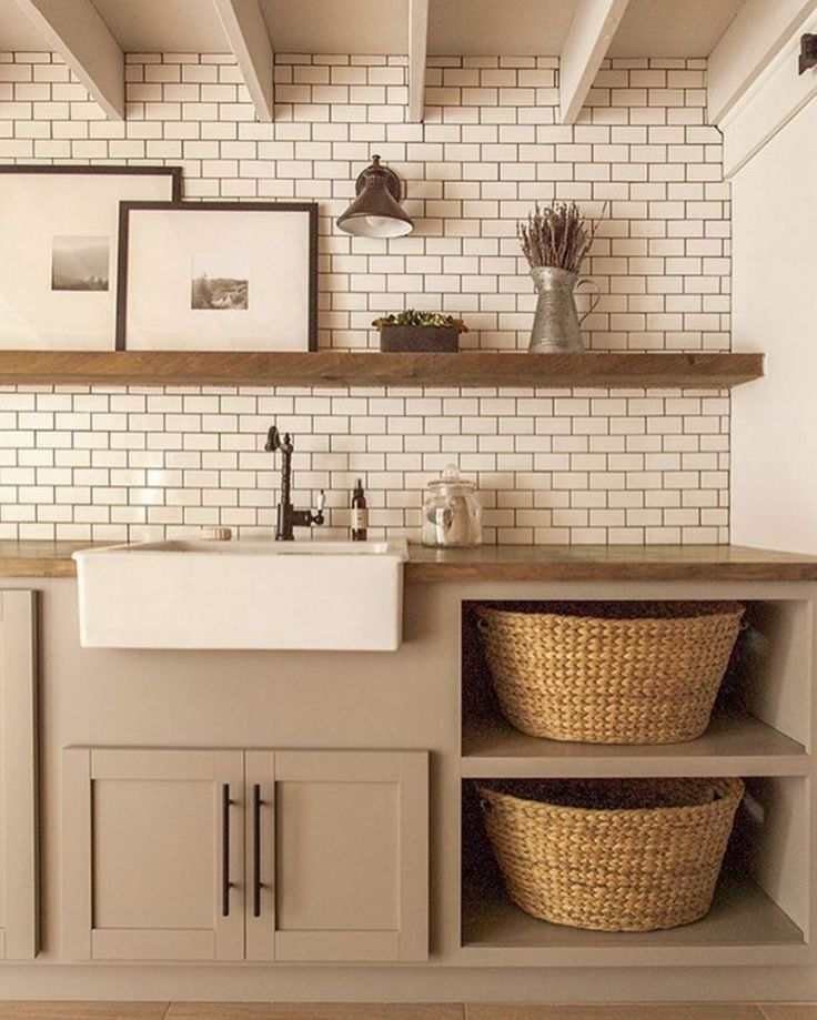 Subway-tiled laundry room with stylish, woven baskets.