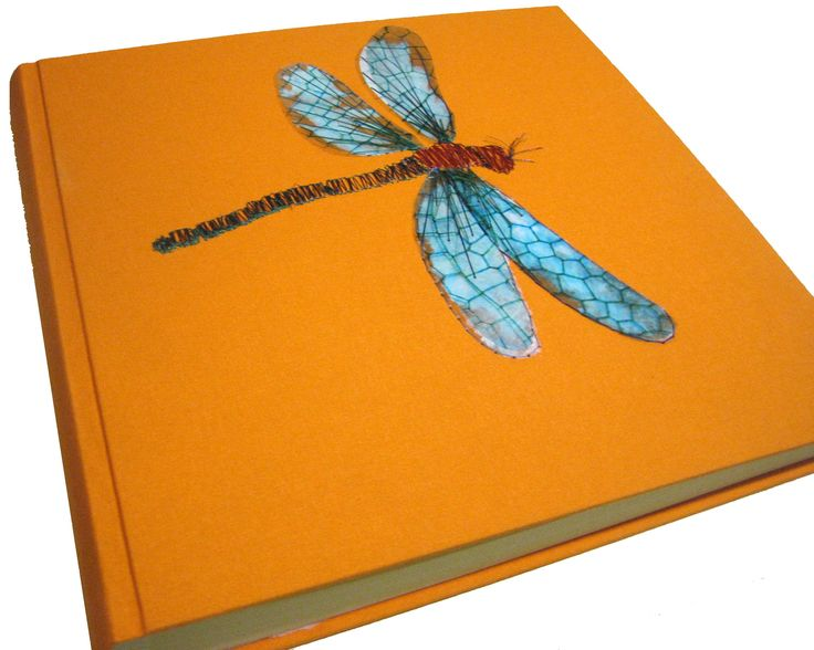 Photo Album .Cloth binding. Emroidered with silk and metalic threads. Print on transparency film.