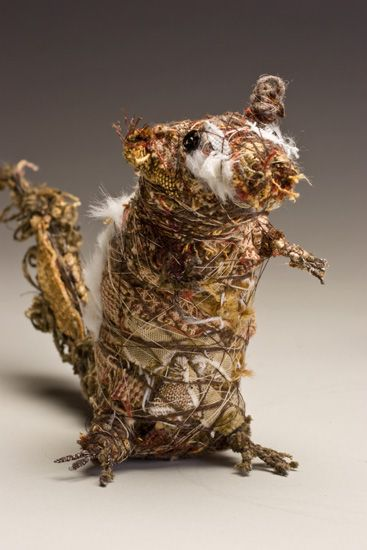 Animals made of wood, wire and pieces of fabric