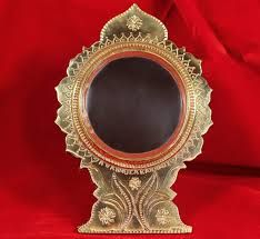 Aranmula Kannadi is a special handicraft mirror from Kerala. It is made of metal, instead of glass unlike the usual mirror. buy it online from devotional Store.  #AranmulaMirror #AranmulaKannadi #Mirror #MetalicMirror #Aranmula #KeralaTraditional #DevotionalStore