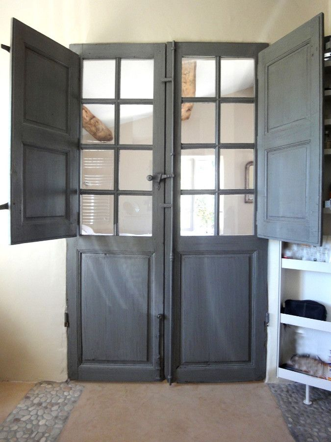 French door with folding shutters Decorative door between bedroom and bathroom. Interior doors . Portes Antiques - french manufacturer, restoring and creation