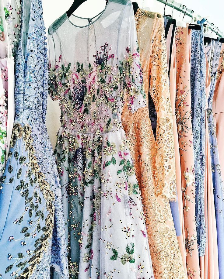 The palette of this rack of Georges Hobeika #couture gowns courtesy of Jenny Cipoletti's #PFW coverage is picture perfect! | WedLuxe Magazine | #wedding #luxury #weddinginspiration #luxurywedding #bridal #weddinggown