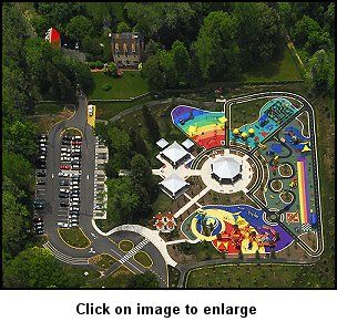 The two-acre playground consists of four outdoor 'rooms' surrounding a centerpiece carousel.