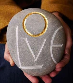 British limestone pebbles carved by hand using a small dummy mallet and tungsten chisel.The letter is drawn onto the pebble and then chislled, gradually widening both sides to a 'v' section (an ancient process also used by Eric Gill), so that the light falls evenly and allows the letter to be illuminated.  A single letter is then gilded with gold leaf.