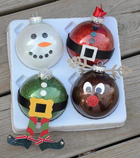 Christmas Ornaments: This is neat, looks  like they used clear ornaments, covered the inside with glitter & painted the accents on the outside,