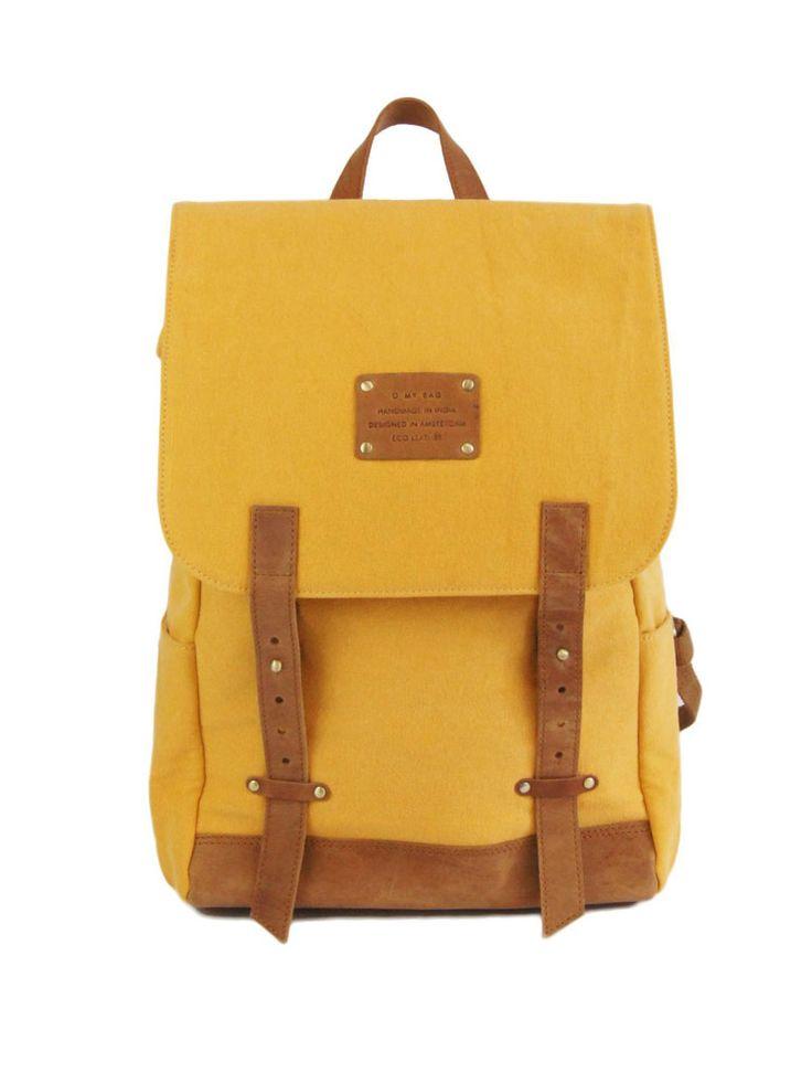 """Mau's Backpack (mosterdgeel) €179,= Mau's backpack is groot genoeg om de alledaagse behoeften aan te pakken. Gemaakt van een stevig mosterdgeel doek en ruig ecoleer. Gebruik hem voor je werk, voor naar school, of op vakantie, hij is er geschikt voor. Er past een 15"""" laptop in, de banden zijn sterk en comfortabel genoeg voor zwaardere ladingen en de tas heeft handige opbergvakken, zowel aan de binnenkant als de buitenkant. Details - Kleur: mosterdgeel / camel - Er past een 15"""" laptop in…"""