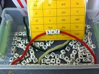Word Work with letter beads and pipe cleaners.