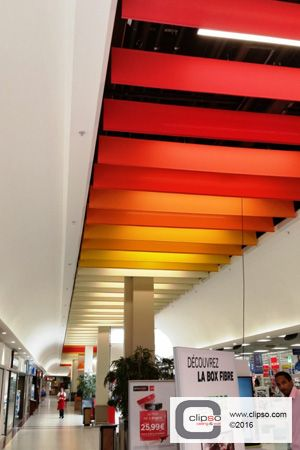 Carrefour retail superstore. France. Materials: Suspended ceiling clouds using Standard Color 705C fabric.