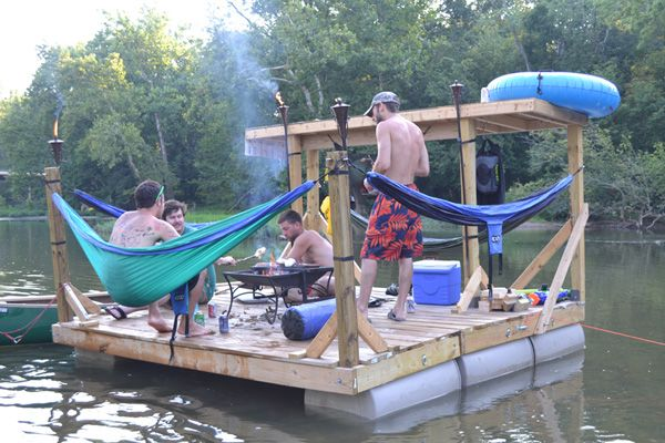 Capable of hanging four hammocks, this raft also features a sturdy shelter, tiki torches, a fire pit with grill and a cinder block anchor!