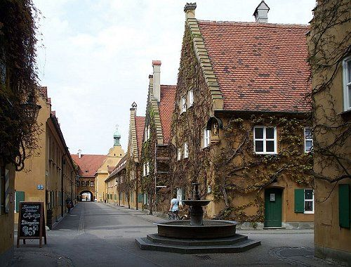 Das ist die Fuggerei. It used to cost one mark a day to live there - look it up! Lived near here some five years in Augsburg Germany. Wonderful people.