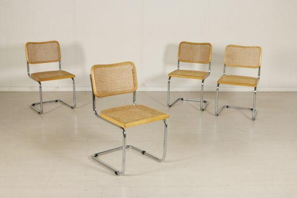 Gruppo di quattro sedie, fedele riproduzione del modello Cesca di Marcel Breuer; tubolare cromato, telaio in legno di faggio e paglia di Vienna. Buone condizioni, presentano piccoli segni di usura.