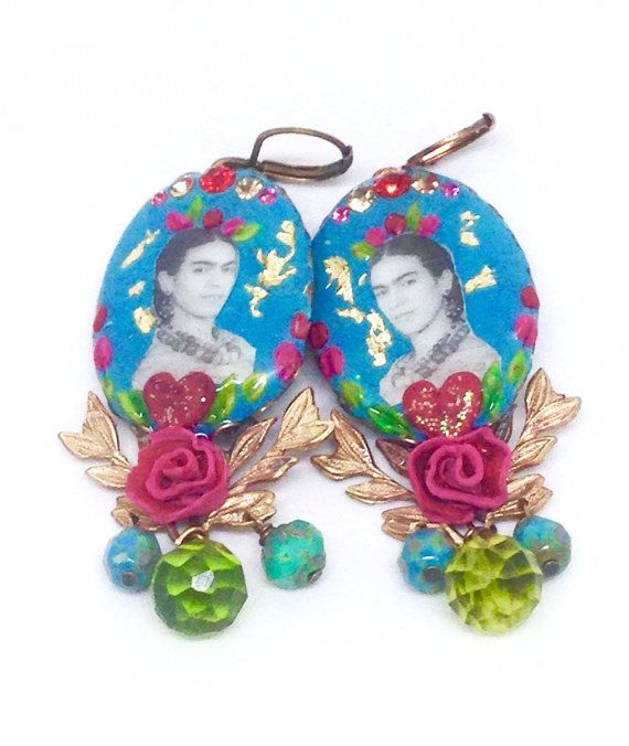 FRIDA EARRINGS IN DUCKEGG, SCARLET, PINK AND GREEN V.4  A handmade pair of gorgeous, dramatic, colourful Cameo earrings with vintage Rhinestones and glass beads.  They feature mirror images of a lovely photo of Frida Kahlo, applied to bright duckegg blue Polymer Clay mixed with flecks of Gold Leaf mounted on an antique finish Brass laced edge setting. The pictures are protected with a layer of hard clear glaze. The cameo is delicately enhanced with a border of sparkling vintage Rhinestones…