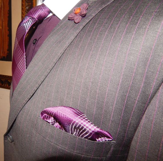 THE PLUM CRAZY TIE COLLECTION, 5-LEAF PURPLE CLOTH LAPEL PIN, CUSTOM MADE SHIRT WITH CONTRAST COLLAR AND CUFFS, 100% WOOL CHARCOAL GREY WITH PURPLE PINSTRIPE SUIT CUSTOM MADE AND DESIGNED BY STYLES BY KUTTY. TIE, POCKET SQUARE AND LAPEL PIN AVAILABLE AT WWW.STYLESBYKUTTY.COM. CUSTOM SUIT AND CUSTOM SHIRT AVAILABLE BY APPOINTMENT ONLY. CONTACT KUTTY @ 561-358-6103 OR INFO@STYLESBYKUTTY.COM