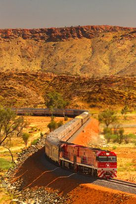 The Ghan .... The 3000km trip between Darwin and Adelaide provides glimpses of Australia's unique landscape and wildlife.  I travelled on the Ghan between Adelaide and Alice Springs in 1982.  Despite travelling through desert, a flood isolated us for several days.  A wonderful, once in a lifetime, experience.