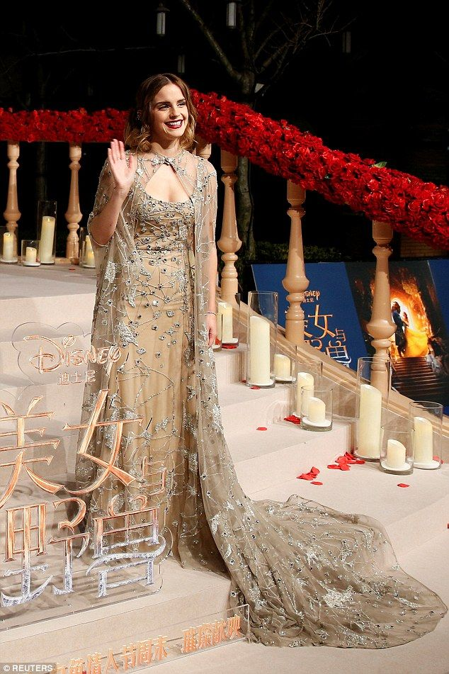 China Doll Princess: Emma Watson looked beautiful in a Elie Saab Haute Couture embellished nude dress with an Enchantress-esque, jewel-covered sheer cloak at the Beauty and the Beast Premiere at the Disneyland Resort in Shanghai, China