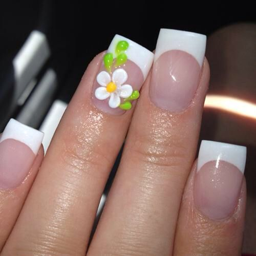 Pretty French manicure with flower accent..