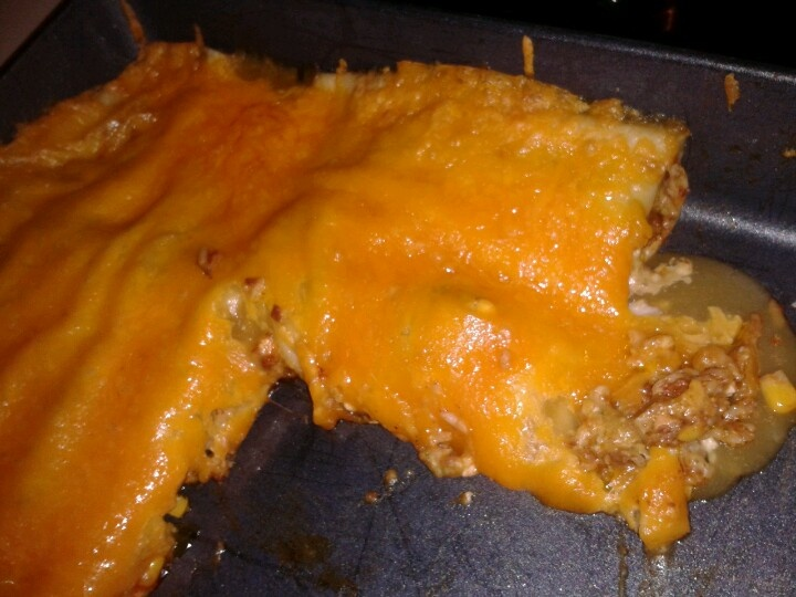 Enchiladas stuffed with homemade El azteco cheese dip and mixture of cooked rice, corn, chorizo.Topped with green enchilada sauce and cheddar cheese.  Serve with salsa and chips.