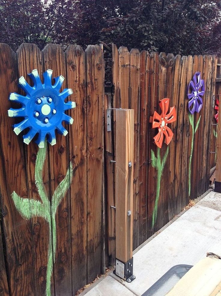 Hmmmmm. Not sure if I should post these on my garden board or the craft board. Hub Cap Fence Flowers :: Hometalk