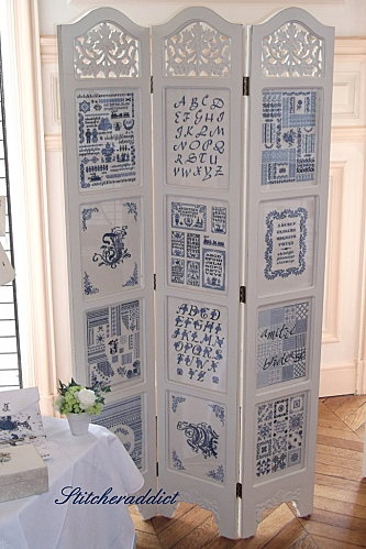 Beautiful chamber screen with blue on white cross stitch patterns and alphabets.