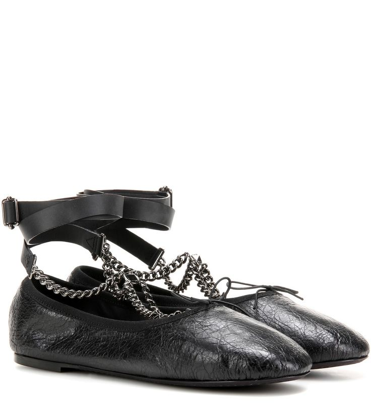 Valentino - Rockstud Ballerina Noir leather ballerinas - Valentino lends the classic, girly ballerina silhouette an achingly cool look courtesy of tough-luxe detailing. The black pair is crafted from a crinkled leather upper for a well-loved look that's topped off with gunmetal-hued chains. Let yours be an edgy statement to feminine dresses. seen @ www.mytheresa.com