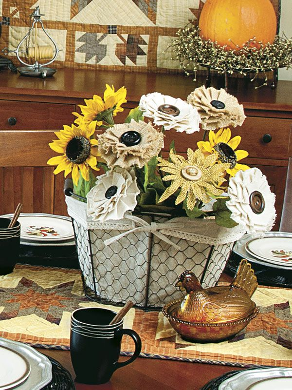 Glue buttons onto decorative fabric flowers and tuck them into a linen-lined wire basket with faux sunflowers for a lovely, long-lasting centerpiece. • To see more of this photo and find out more about the items shown, turn to page 148 of our September 2014 issue or page 60 of our online Craft Fair, http://www.countrysampler.com/craftfair/flipbook.php?issue_code=C0914 • Preview the issue: http://www.countrysampler.com/issues/detail.php?issue_code=C0914