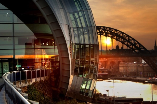 The Tyne Bridge peeking out from behind The Sage Gateshead