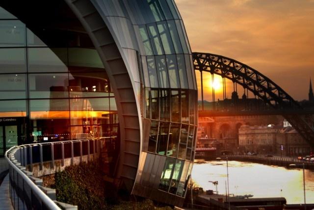 The Tyne Bridge peeking out from behind The Sage Gateshead