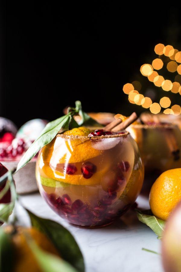 Christmas Sangria -a little white wine, ginger beer, apple cider, brandy, a few pears & oranges + pomegranate arils - so delish! From halfbakedharvest.com