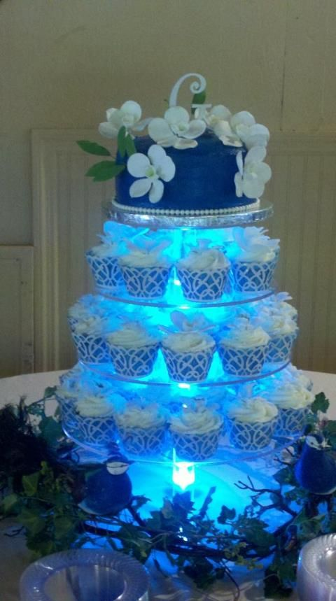ORCHIDS AND PEACOCK WEDDING CUPCAKE TOWER