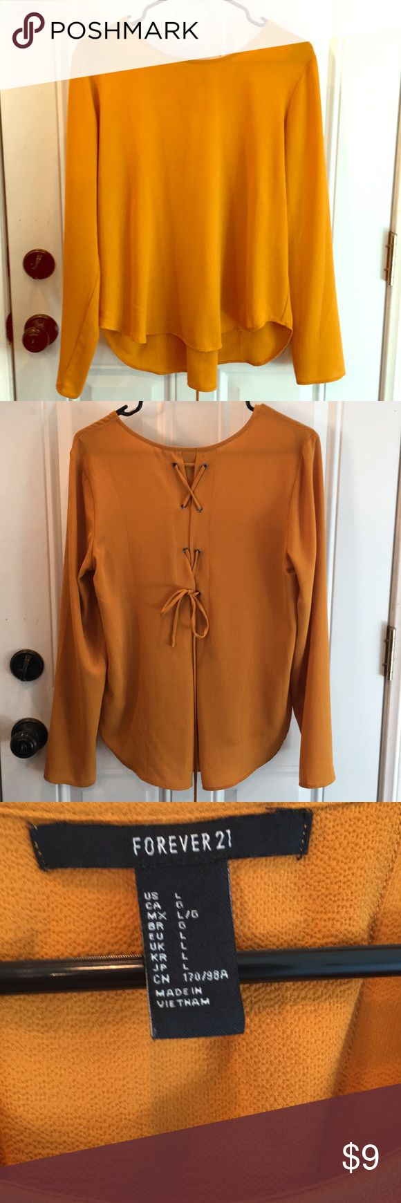 L Forever 21 Mustard yellow long sleeve top L Forever 21 Mustard yellow long sleeve top. Cute detailing on the back. Worn once. Forever 21 Tops Blouses