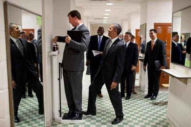 Obama stepping on the back of the scale.