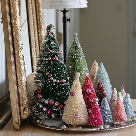 All you need to make your own adorable bottle brush Christmas trees is some sisal rope, thin wire, craft glue, and a few other supplies.