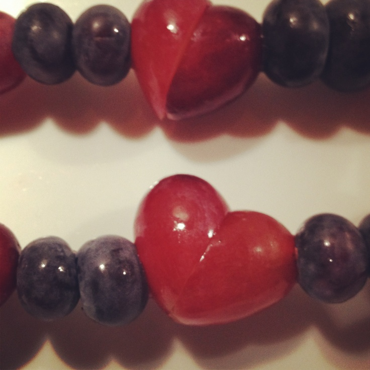 Valentine fruit!!! Cut a grape at an angle and turn it together to make a…