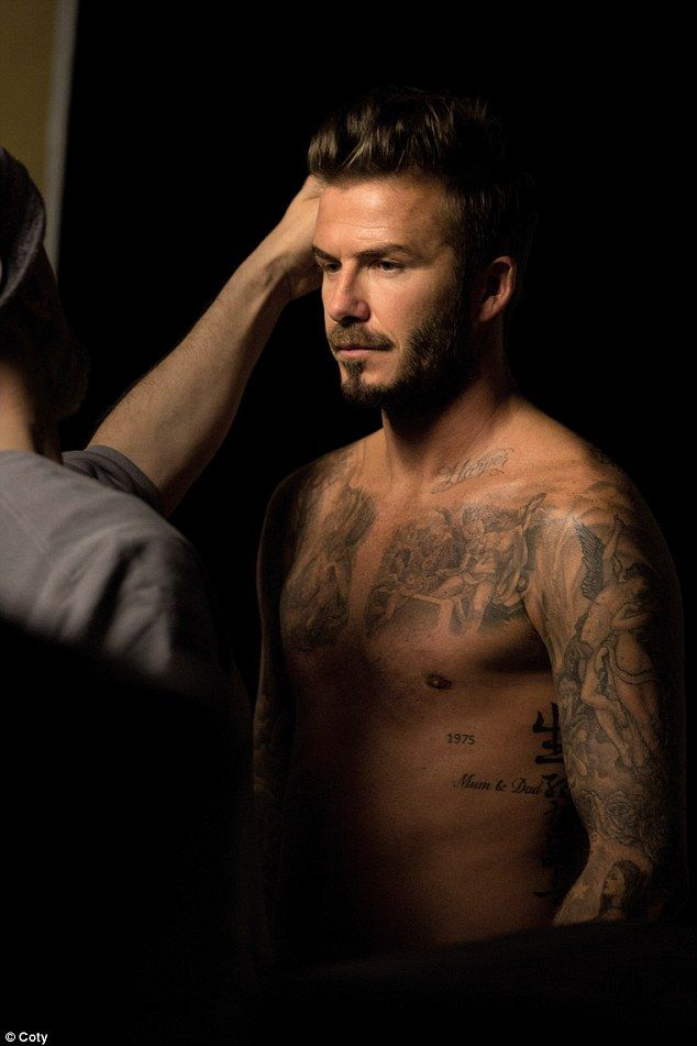 Working it: David Beckham is sure to set pulses racing as he shows off his incredibly toned body in behind-the-scenes shots for his fragrance campaign, David Beckham Beyond.