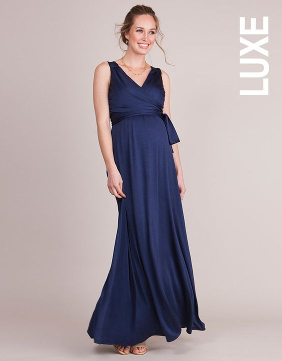 Make a sweeping entrance at your next evening event in the Navy Blue Maternity Evening Dress. Made in luxury draped fabric, the slinky style falls beautifully over your curves, creating a stunning silhouette for every stage of pregnancy. After baby is born, chic ballet-style ties wrap across your bust, concealing a hidden panel with discreet openings for nursing. Transitioning seamlessly into your new mum wardrobe, the ties cross over at the front to create a flattering v neckline and can be…