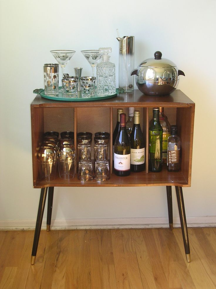 Vintage Record Cabinet Bar. I took off the sliding doors and it now holds my vintage barware and our booze.