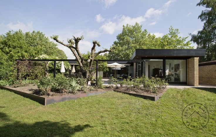60's house danish architecture. Yellow bricks black wood, large windows