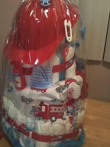 The backside of my fireman diaper cake