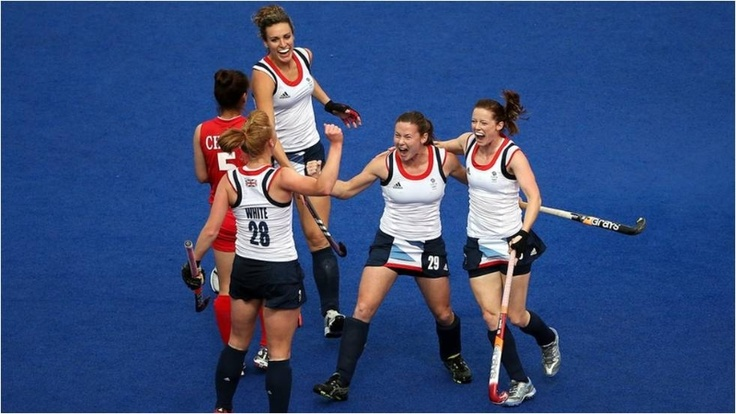 Nicola White of Great Britain celebrates scoring with her team-mates during the women's hockey match between Great Britain and South Korea at Riverbank Arena