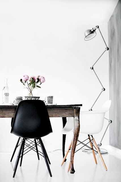white rooms, eames chairs and peonies! love the modern chairs with the vintage table