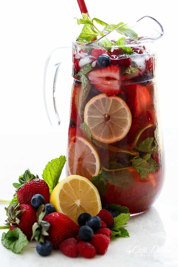 A beautiful and refreshing spin on a traditional sangria using a mixture of frozen berries for a full berry flavour, a simple to make strawberry syrup, and the sweet Italian tangy-sweet citrus from limoncello! | http://cafedelites.com