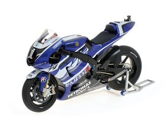 Yamaha YZR-M1 (Jorge Lorenzo - MotoGP 2011) Diecast Model Motorcycle Minichamps 122113001 1:12 scale in Blue This Yamaha YZR-M1 (Jorge Lorenzo - MotoGP 2011) Diecast Model Motorcycle is Blue and features working stand, steering, suspension, wheels. It is made by Minichamps and is 1:12 scale (approx. 18cm / 7.1in long).