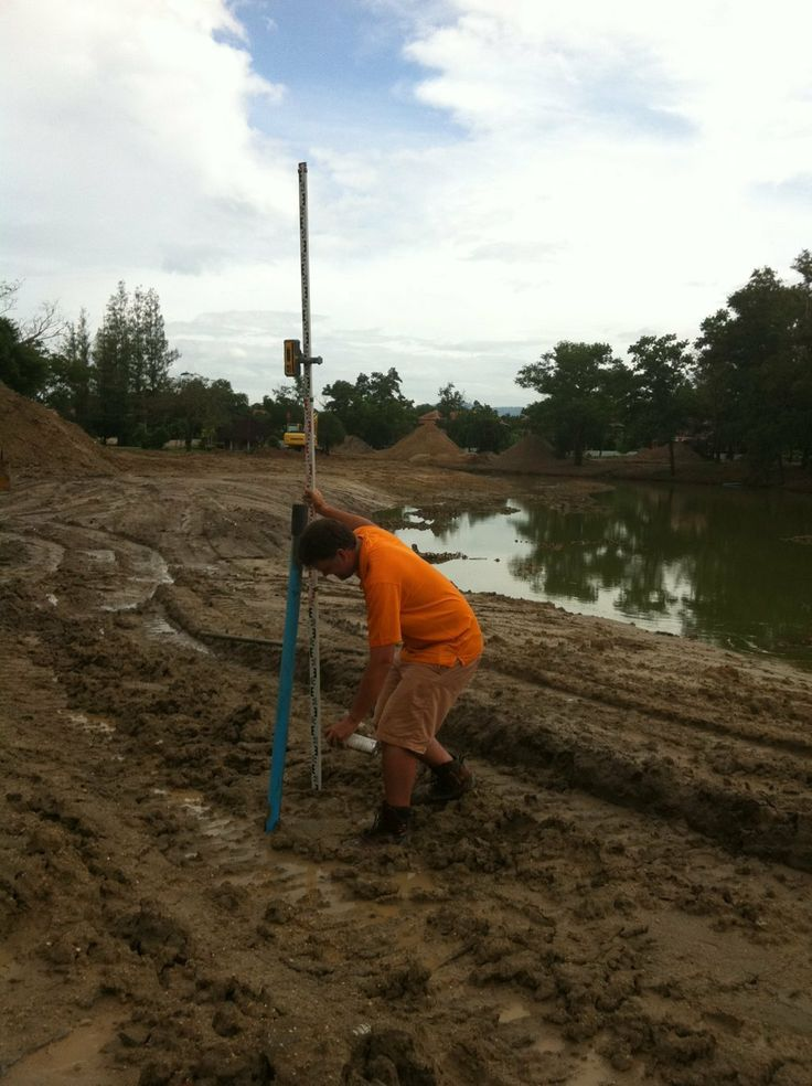 Survey work in the mud in Phuket