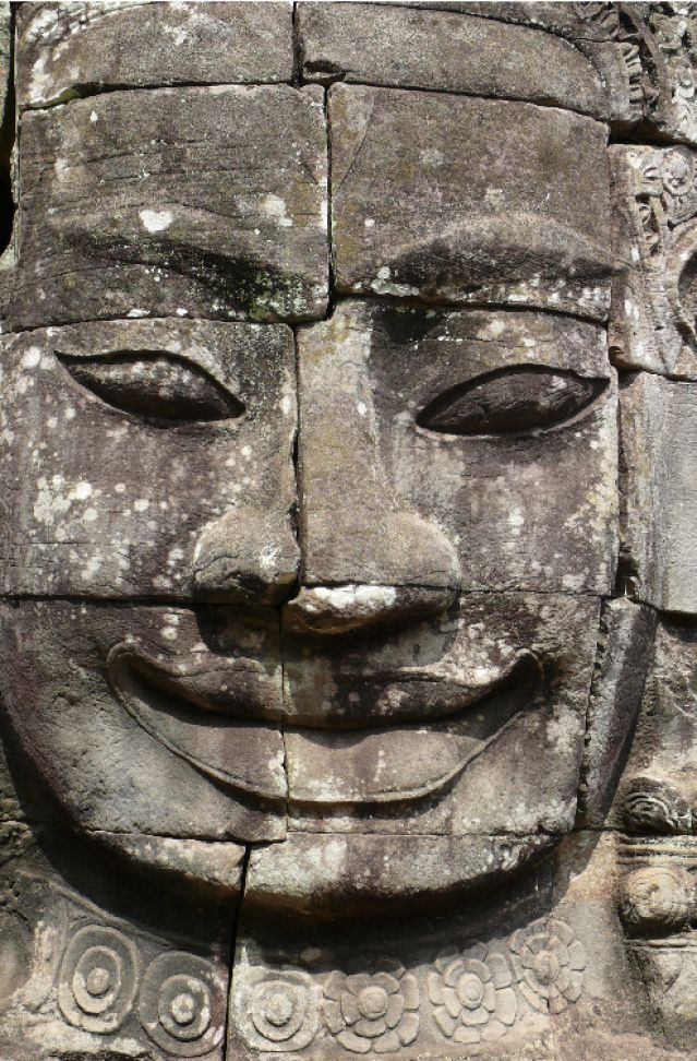 The Collapse of Angkor: One of the over two hundred faces carved in the towers of Bayon, a 12th century Angkorian temple. The faces may be representations of Buddha, the bodhisattva Lokesvara, Angkorian King Jayavarman VII, who built the temple, or a combination