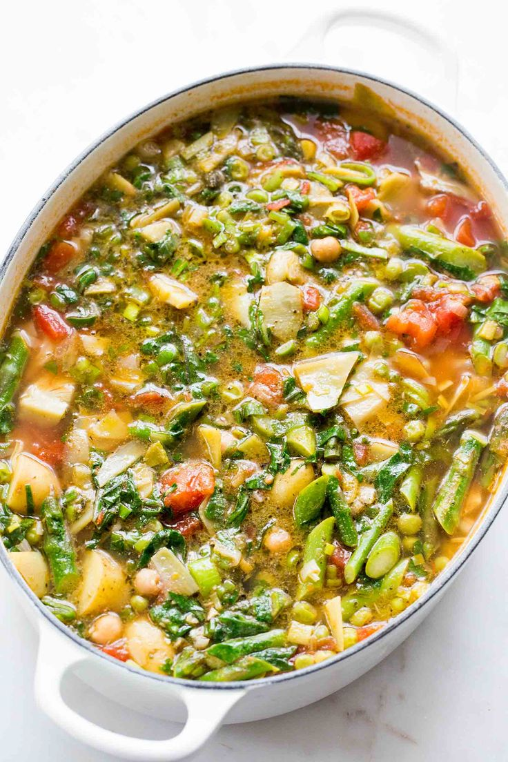 Spring Minestrone! A springtime version of the classic Italian minestrone, with peas, new potatoes, artichoke hearts, asparagus and spring greens.