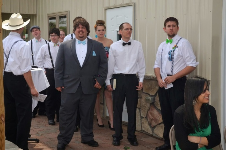 My groom, groomsmen, and ushers :D I had the ushers wear checkered suspenders and colored bow ties to give them more of a Tweedle feel. I bought those at Hot Topic.The groomsmen had plain black suspenders and multi-colored pastel bow ties. Rented the suspenders and the bow ties we bought from Etsy.