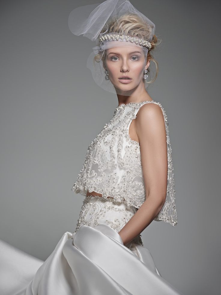 Sottero and Midgley - DHARMA, Luxurious and utterly breathtaking, this two-piece ball gown wedding dress is the epitome of glamour with a voluminous Vizela Mikado skirt with side seam pockets and a cropped, bead encrusted, lace top with Swarovski crystals. Finished with bateau neckline and zipper closure.