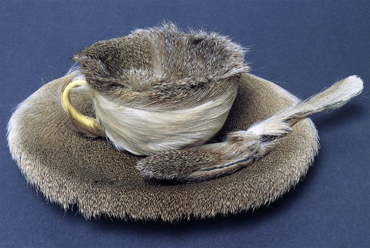 """Meret Oppenheim. Object. 1936. Fur-covered cup, saucer, and spoon, cup 4-3/8 inches in diameter; saucer 9-3/8 inches in diameter; spoon 8 inches long, overall height 2-7/8"""" (The Museum of Modern Art)"""