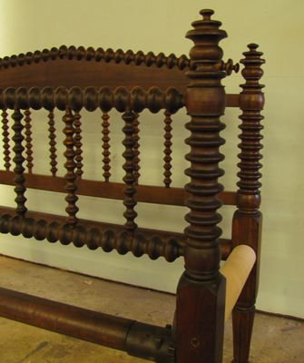 A fine example of a Jenny Lind or spool bed room about 1850. This example is made of black walnut with round maple rails. The side rails are missing.