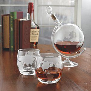 Get away with every sip with these etched globe spirits glasses. Admire and enjoy these glasses from north, south, east and west. Decorative etching of the world map brings a new spin on serving spirits. Set includes etched glass decanter stopper and glass base, and set of 2 etched glasses.